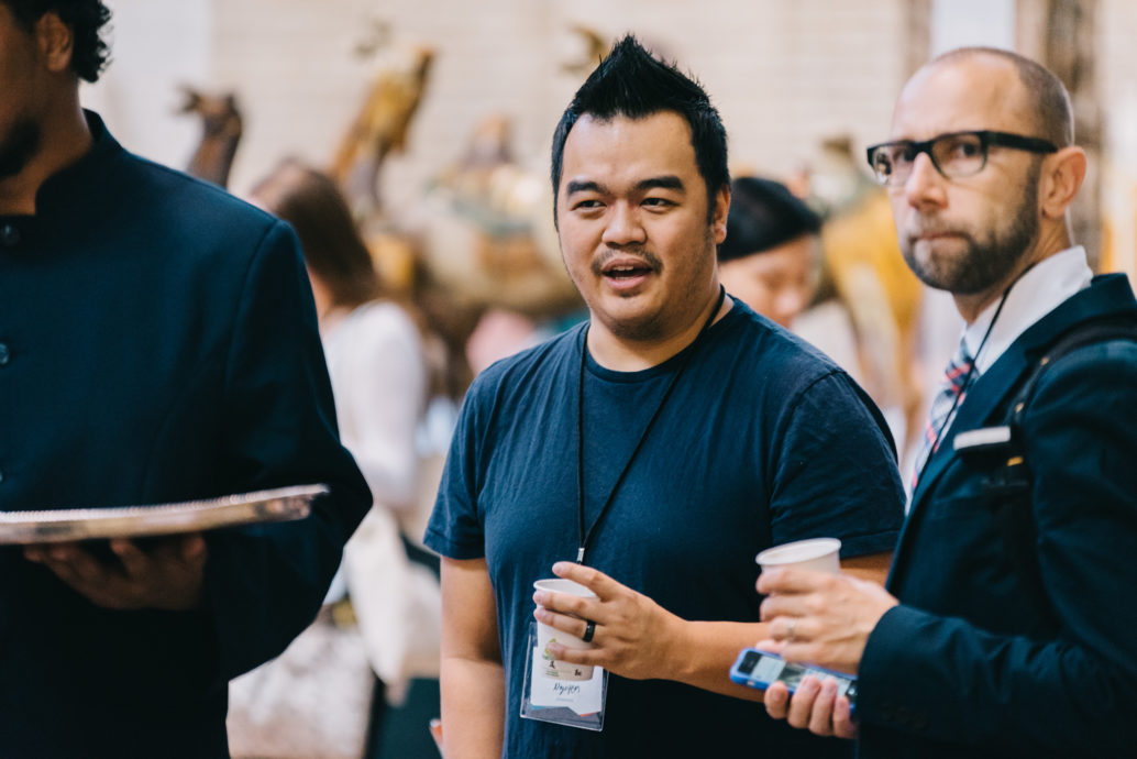 Forge Committee member Tony Nguyen, and Forge attendees await the start of the opening keynote